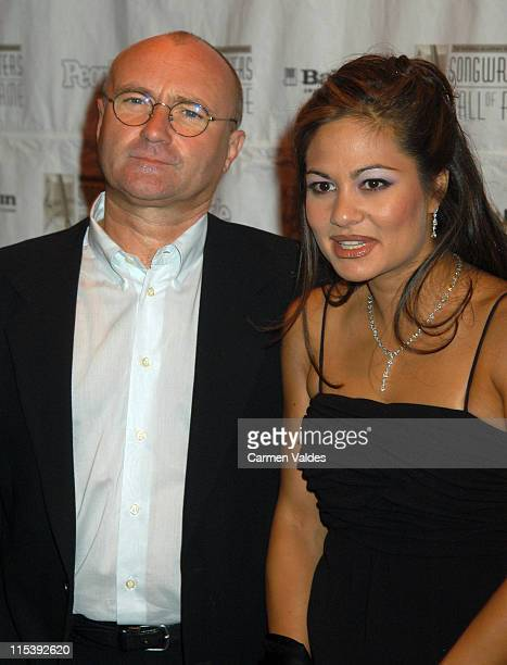 Phil Collins and Orianne Collins during 34th Annual Songwriters Hall Of Fame Awards Pressroom at Marriott Marquis in New York City New York United...