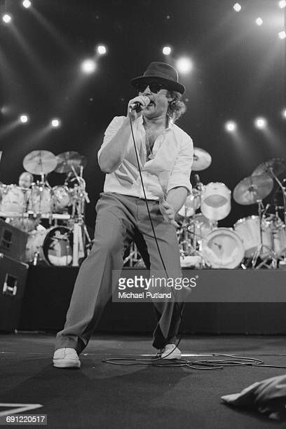 Phil Collins performing with English rock group Genesis at the Rosemont Horizon Rosemont Illinois during the band's Invisible Touch Tour October 1986