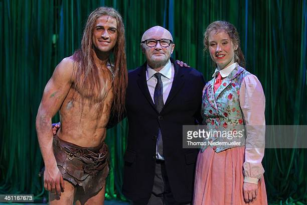 Phil Collins pose with Gian Marco Schiaretti 'Tarzan' and Merle Hoch 'Jane' after the Stuttgart Premiere of the musical 'Tarzan' at Stage Apollo...