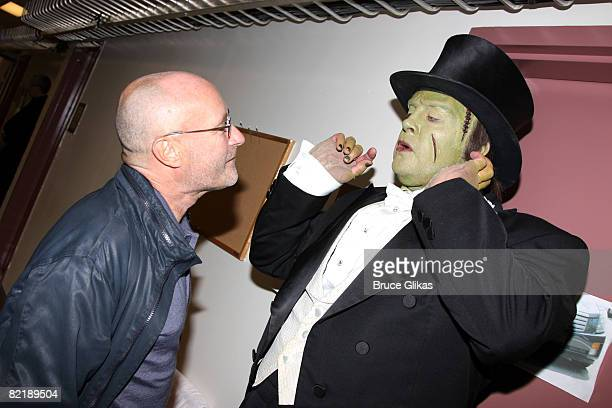 COVERAGE* Phil Collins poses with Shuler Hensley dressed as 'The Monster' backstage at 'Young Frankenstein' on Broadway at the Hilton Theatre on...