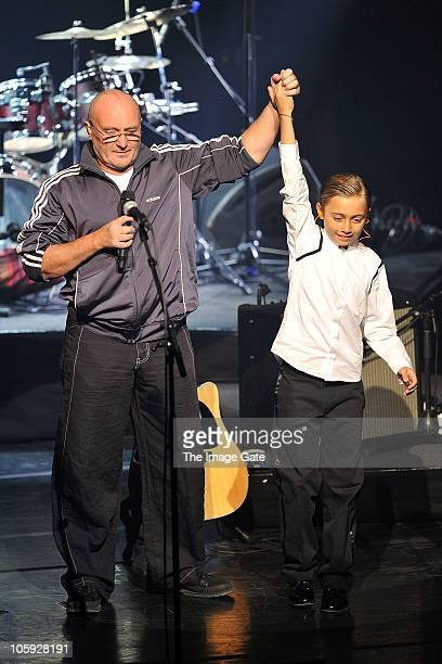 Phil Collins thanks his son Nicholas Collins who played the drums as his father was unable to perform due to his hand condition during the Little...