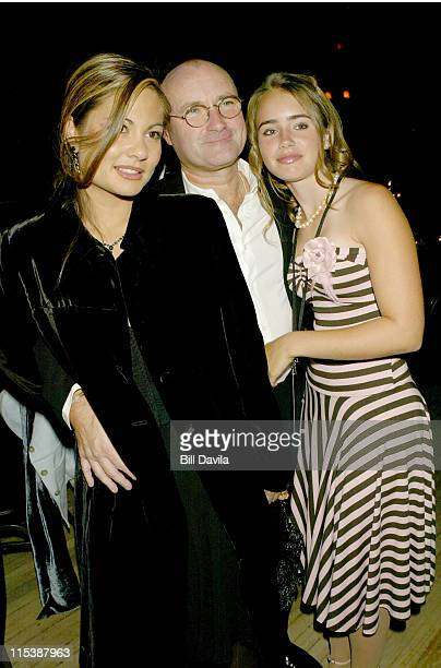 Phil Collins with wife Orianne with daughter Lily during New York Premiere Of 'Brother Bear' After Party at Roseland Ballroom in New York NY United...