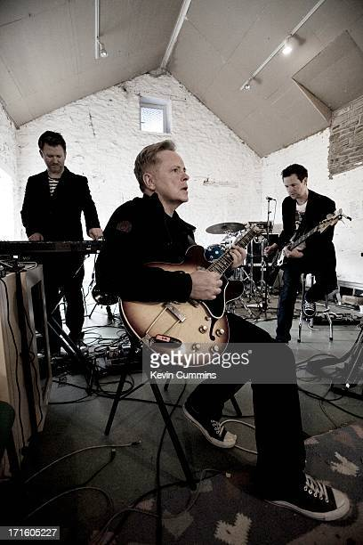 Phil Cunningham Bernard Sumner and Tom Chapman of New Order in the band's rehearsal studio UK 22nd September 2011 Sumner is playing a Gibson ES330...
