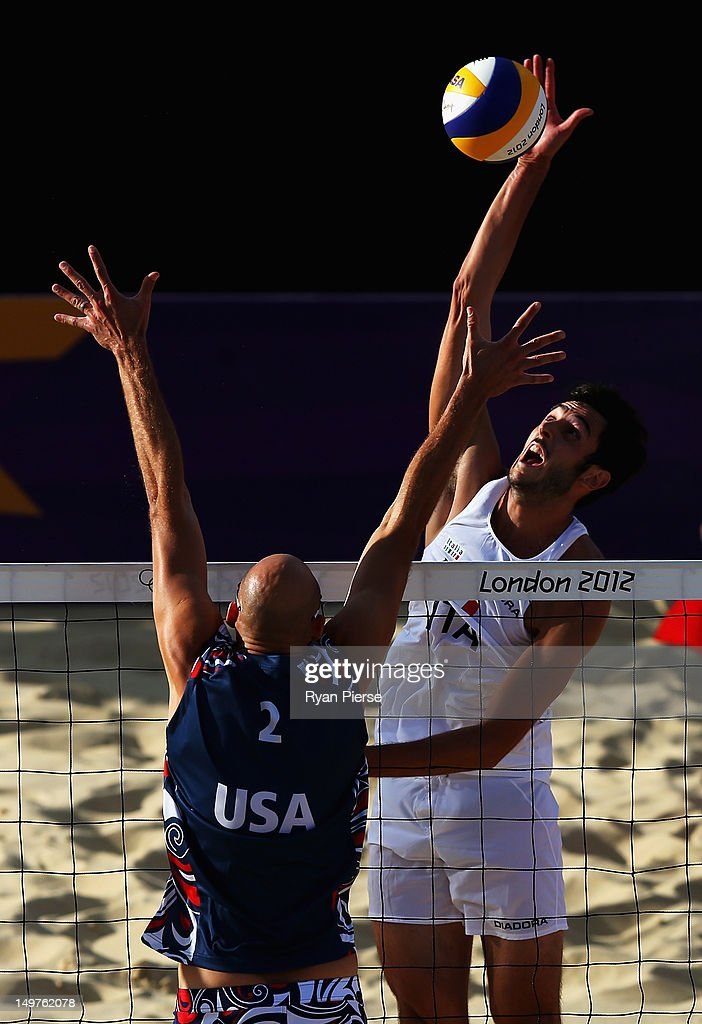 Phil Dalhausser of the United States blocks the shot of Paolo Nicolai of Italy during the Men's Beach Volleyball Round of 16 match between United States and Italy on Day 7 of the London 2012 Olympic Games at Horse Guards Parade on August 3, 2012 in London, England.