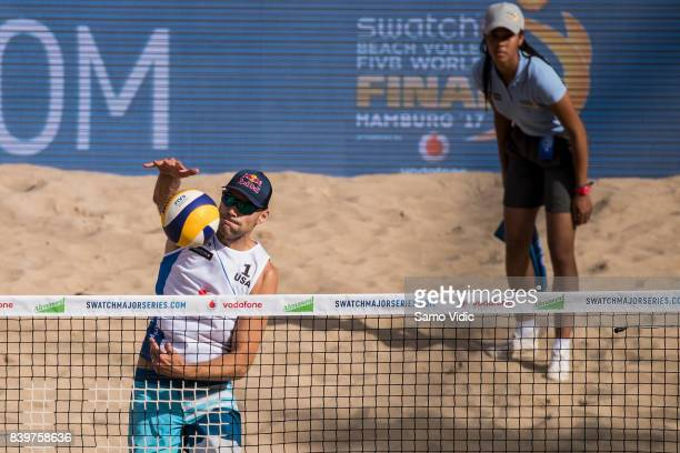 Phil Dalhausser of the United States spikes the ball during the semi final match against Piotr Kantor and Bartosz Losiak of Poland at the Swatch...