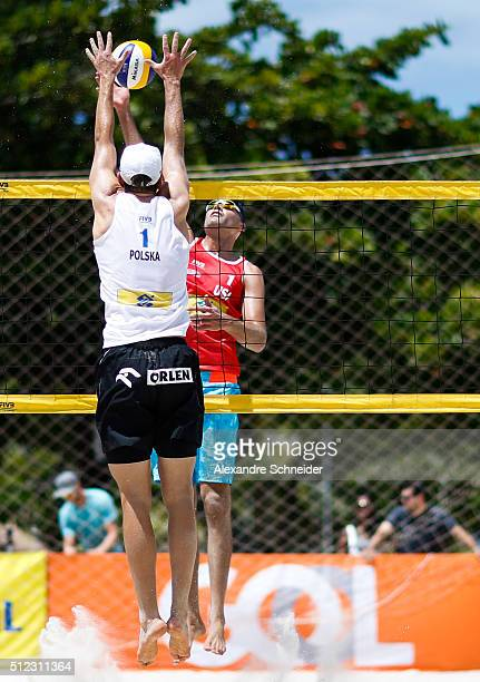 Phil Dalhausser of the United States spikes the ball in the main draw match against Poland at Pajucara beach during day three of the FIVB Beach...