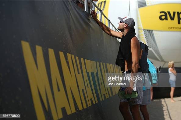 Phil Dalhausser stops to sign an autograph after forfeiting his semi final match due to a calf injury at the AVP Beach Volleyball Manhattan Beach at...
