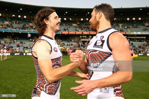 Phil Davis and Shane Mumford of the Giants celebrate after winning the round 10 AFL match between the West Coast Eagles and the Greater Western...
