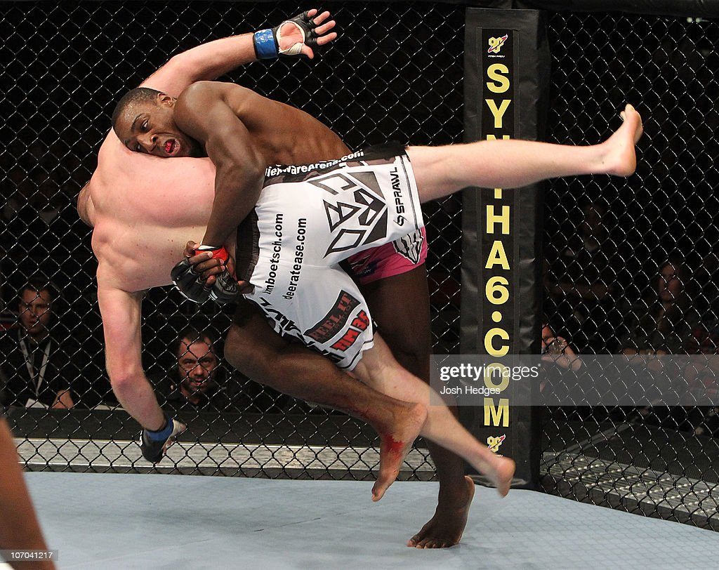 Phil Davis flips Tim Boetsch during their Light Heavyweight bout part of UFC 123 at the Palace of Auburn Hills on November 20 2010 in Auburn Hills...