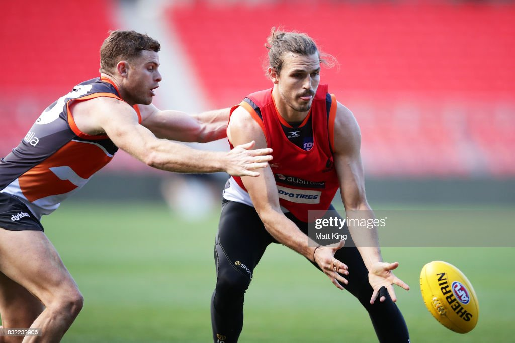 Phil Davis (R) is challenged by Heath Shaw (L) during a Greater Western Sydney Giants AFL training session at Spotless Stadium on August 16, 2017 in Sydney, Australia.