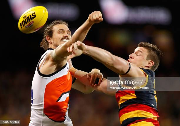 Phil Davis of the Giants and Josh Jenkins of the Crows compete for the ball during the AFL First Qualifying Final match between the Adelaide Crows...