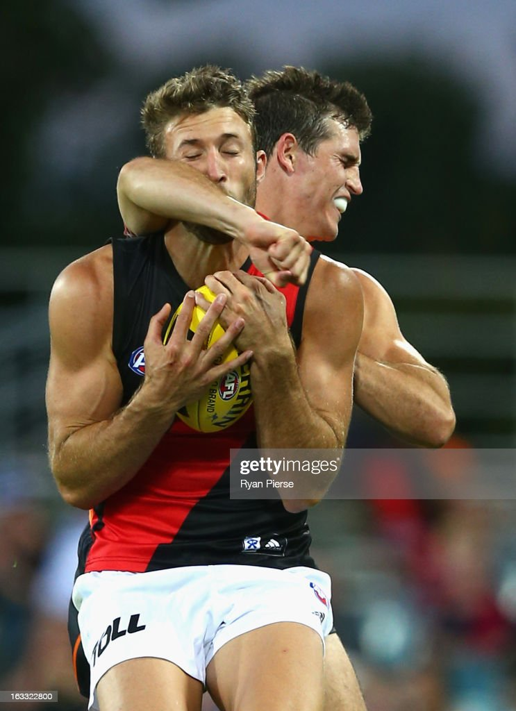 Phil Davis of the Giants contests the ball against Cale Hooker of the Bombers during the round three of the NAB Cup AFL match between the Greater Western Sydney Giants and the Essendon Bombers at Manuka Oval on March 8, 2013 in Canberra, Australia.