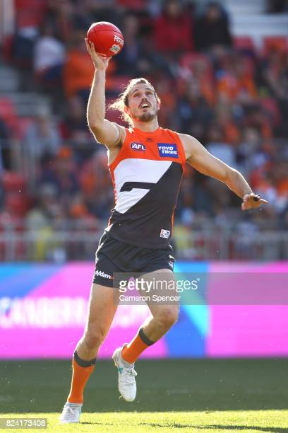 Phil Davis of the Giants gathers the ball during the round 19 AFL match between the Greater Western Sydney Giants and the Fremantle Dockers at...