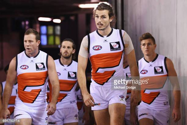 Phil Davis of the Giants leads the team out during the round 12 AFL match between the Carlton Blues and the Greater Western Sydney Giants at Etihad...