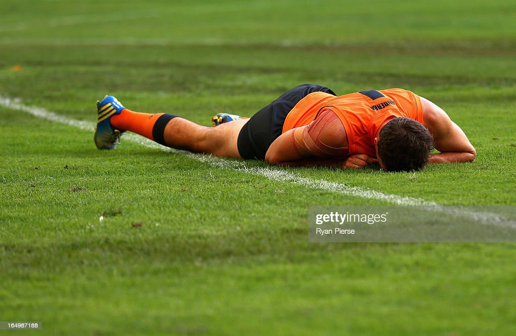 Phil Davis of the Giants lies on the ground after injuring his hip during the round one AFL match between the Greater Western Sydney Giants and the Sydney Swans at ANZ Stadium on March 30, 2013 in Sydney, Australia.
