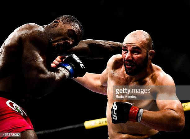 Phil Davis of the United States punches Glover Teixeira of Brazil in their light heavyweight bout during the UFC 179 event at Maracanazinho on...