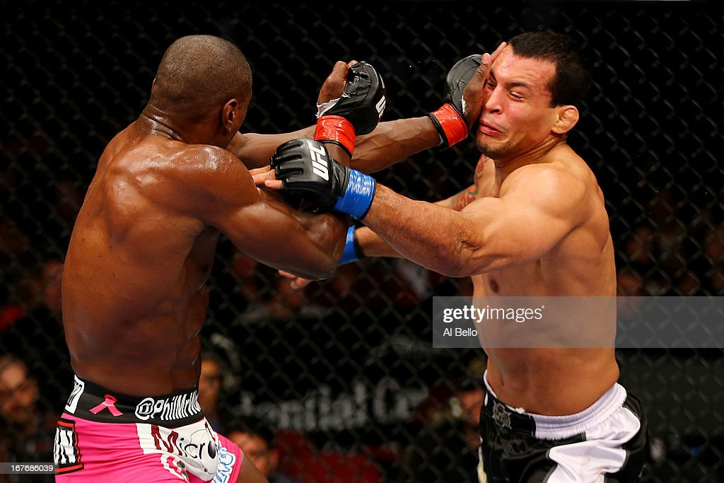 Phil Davis throws a punch against Vinny Magalhaes in their light heavyweight bout during the UFC 159 event at the Prudential Center on April 27, 2013 in Newark, New Jersey.
