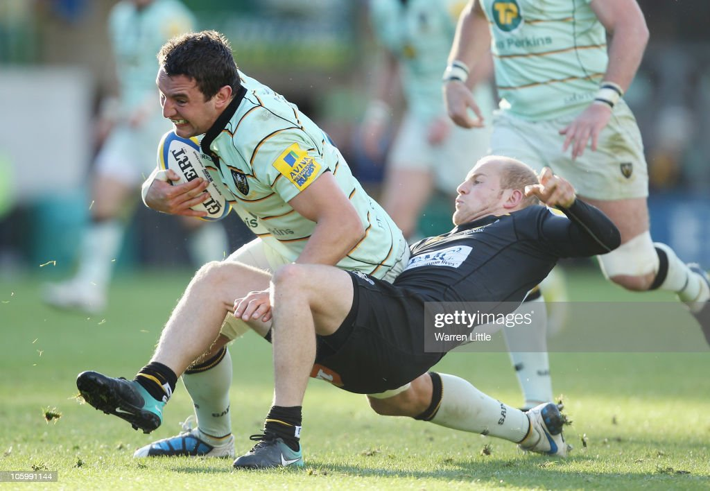 Phil Dawson of Northampton Saints is tackled by Joe Simpson of London Wasps during the AVIVA Premiership match between London Wasps and Northampton Saints at Adams Park on October 24, 2010 in High Wycombe, England.