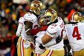 Phil Dawson of the San Francisco 49ers celebrates with teammates Anthony Dixon Daniel Kilgore and Andy Lee after kicking a 33 yard field goal to...