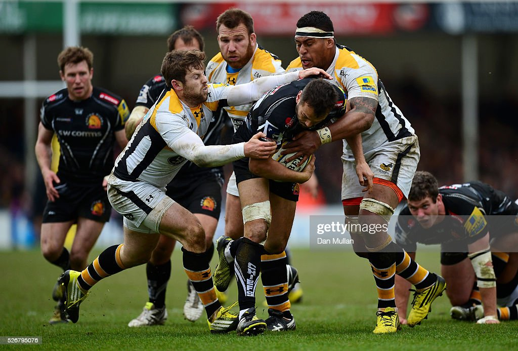 Phil Dollman of Exeter Chiefs breaks the tackle of <a gi-track='captionPersonalityLinkClicked' href=/galleries/search?phrase=Elliot+Daly&family=editorial&specificpeople=6751828 ng-click='$event.stopPropagation()'>Elliot Daly</a> and <a gi-track='captionPersonalityLinkClicked' href=/galleries/search?phrase=Nathan+Hughes+-+Joueur+de+rugby&family=editorial&specificpeople=13679063 ng-click='$event.stopPropagation()'>Nathan Hughes</a> of Wasps to score his side's second try during the Aviva Premiership match between Exeter Chiefs and Wasps at Sandy Park on May 01, 2016 in Exeter, England.