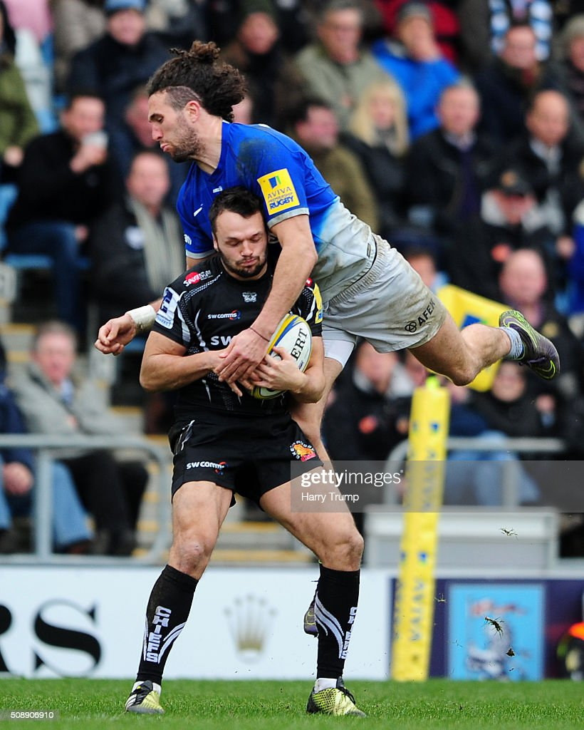 Phil Dollman of Exeter Chiefs is tackled by Mike Ellery of Saracens during the Aviva Premiership match between Exeter Chiefs and Saracens at Sandy Park on February 7, 2016 in Exeter, England.
