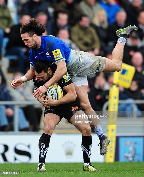 Phil Dollman of Exeter Chiefs is tackled by Mike Ellery of Saracens during the Aviva Premiership match between Exeter Chiefs and Saracens at Sandy...