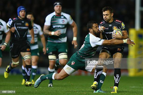 Phil Dollman of Exeter Chiefs is tackled by Telusa Veainu of Leicester Tigers during the Aviva Premiership match between Exeter Chiefs and Leicester...