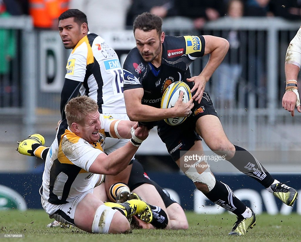 Phil Dollman of Exeter is tackled by <a gi-track='captionPersonalityLinkClicked' href=/galleries/search?phrase=Bradley+Davies&family=editorial&specificpeople=677663 ng-click='$event.stopPropagation()'>Bradley Davies</a> during the Aviva Premiership match between Exeter Chiefs and Wasps at Sandy Park on May 1, 2016 in Exeter, England.