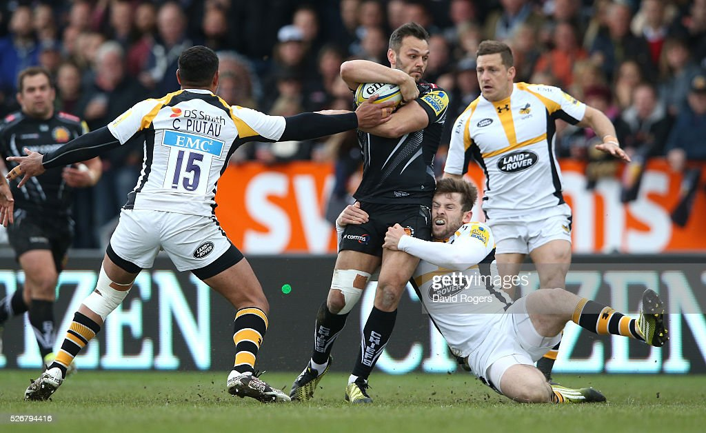 Phil Dollman of Exeter is tackled by <a gi-track='captionPersonalityLinkClicked' href=/galleries/search?phrase=Elliot+Daly&family=editorial&specificpeople=6751828 ng-click='$event.stopPropagation()'>Elliot Daly</a> and <a gi-track='captionPersonalityLinkClicked' href=/galleries/search?phrase=Charles+Piutau&family=editorial&specificpeople=7158787 ng-click='$event.stopPropagation()'>Charles Piutau</a> (L) during the Aviva Premiership match between Exeter Chiefs and Wasps at Sandy Park on May 1, 2016 in Exeter, England.