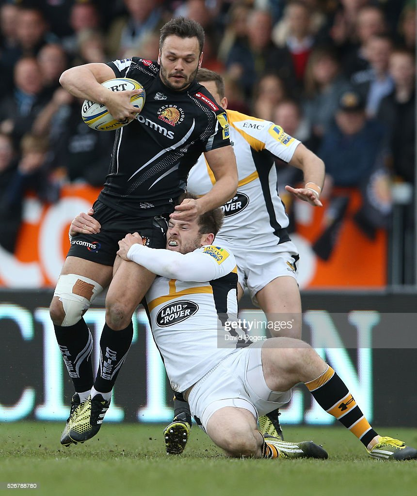 Phil Dollman of Exeter is tackled by Elliot Daly during the Aviva Premiership match between Exeter Chiefs and Wasps at Sandy Park on May 1, 2016 in Exeter, England.