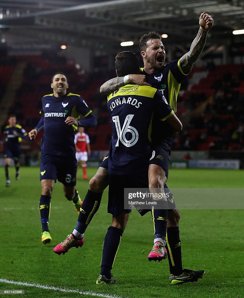 Phil Edwards of Oxford United is congratulated Chris Maguire, after scoring his teams second goal during The Emirates FA Cup Third Round match between Rotherham United and Oxford United at The New York Stadium on January 7, 2017 in Rotherham, England.