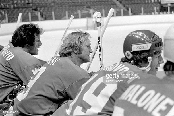 Phil Esposito and Bobby Hull of team Canada look on from the bench during practice for the Canada Cup series at the Montreal Forum circa September...