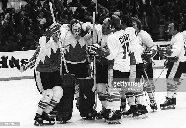 Phil Esposito goalie Ken Dryden Gary Bergman and Paul Henderson of Canada celebrate after Game 6 of the 1972 Summit Series on September 24 1972 at...