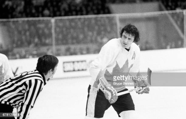 Phil Esposito of Canada talks to the referee during a game against the Soviet Union in the 1972 Summit Series circa September 1972 at the Luzhniki...