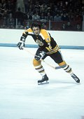 Phil Esposito of the Boston Bruins skates on the ice during an NHL game against the Montreal Canadiens circa 1972 at the Montreal Forum in Montreal...