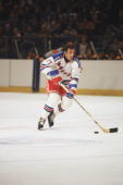 Phil Esposito of the New York Rangers skates with the puck during a game at Madison Square Garden circa 1979 in New York New York