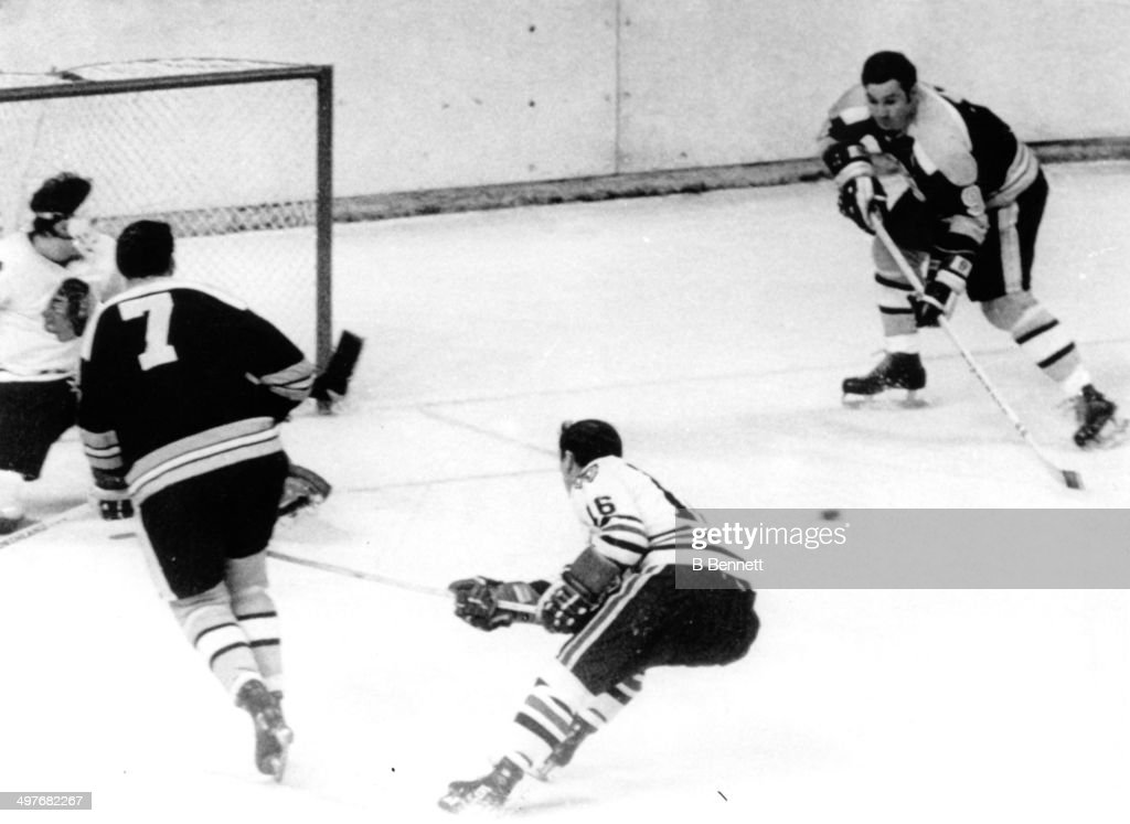 <a gi-track='captionPersonalityLinkClicked' href=/galleries/search?phrase=Phil+Esposito&family=editorial&specificpeople=214575 ng-click='$event.stopPropagation()'>Phil Esposito</a> #7 passes to John Bucyk #9 of the Boston Bruins to score against goalie Tony Esposito #35 of the Chicago Blackhawks as Chico Maki #16 of the Blackhawks follows behind during Game 3 of the 1970 Semi-Finals on April 23, 1970 at the Boston Garden in Boston, Massachusetts.