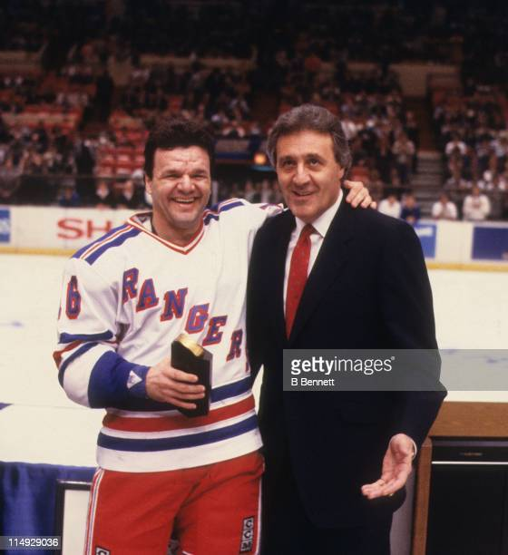 Phil Esposito poses with Marcel Dionne of the New York Rangers after Dionne passed Esposito with his 718th career goal during the game against the...
