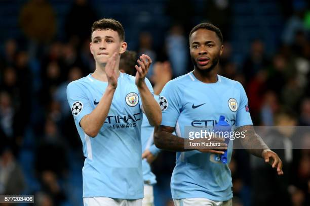 Phil Foden and Raheem Sterling of Manchester City celebrate after the UEFA Champions League group F match between Manchester City and Feyenoord at...
