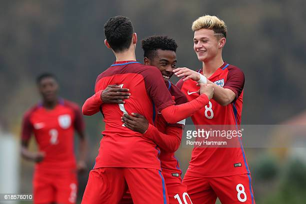 Phil Foden of England celebrates after scoring his team's second goal with Angel Gomes and George McEachran of England during the UEFA Under17 EURO...