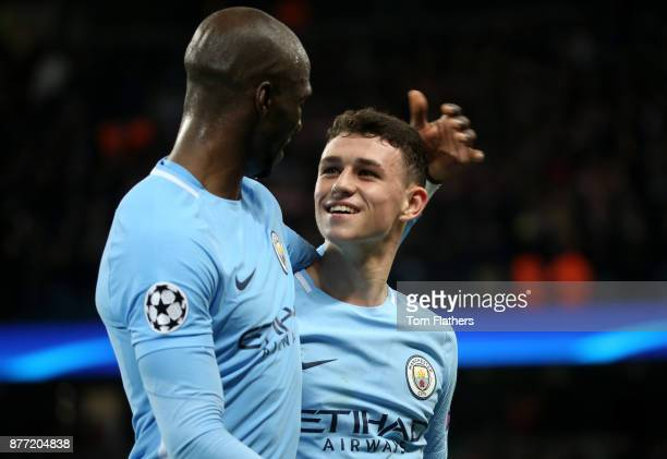 Phil Foden of Manchester City and Eliaquim Mangala of Manchester City celebrate during the UEFA Champions League group F match between Manchester...