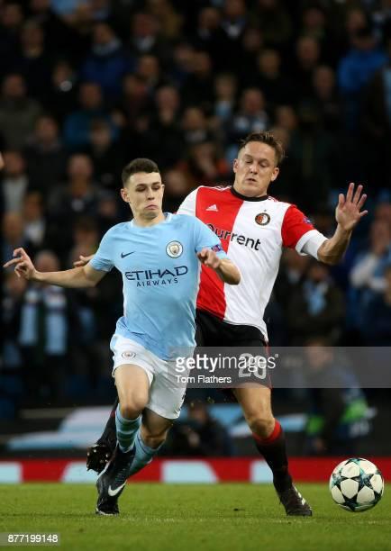 Phil Foden of Manchester City holds off Jens Toornstra of Feyenoord during the UEFA Champions League group F match between Manchester City and...