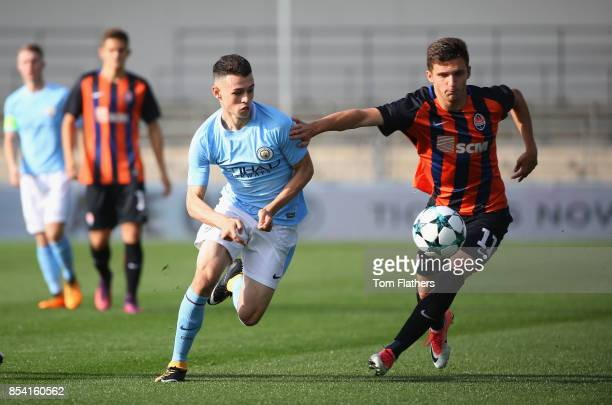Phil Foden of Manchester City takes on Artem Kholod of Shakhtar Donetsk during the UEFA Youth League Group F match between Manchester City and...