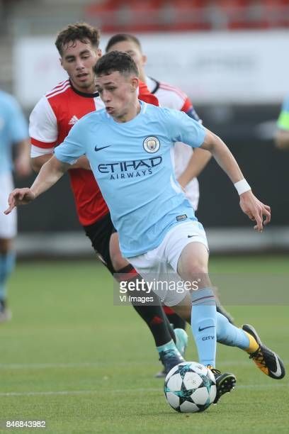 Phil Foden of Manchester City U19 Orkun Kokcu of Feyenoord U19 during the UEFA Youth League match between Feyenoord Rotterdam U19 and Manchester City...