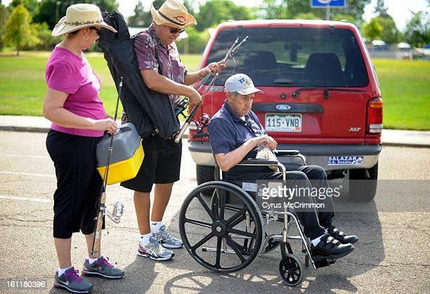 Phil Gallegos center and pushes his dad Jose Gallegos on Thursday June 14 2012 as they go fishing with Phil's wife Claudia left in Northglenn Phil...