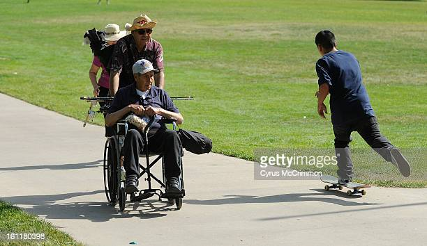 Phil Gallegos center and pushes his dad Jose Gallegos on Thursday June 14 2012 as they go fishing with Phil's wife Claudia behind Phil in Northglenn...