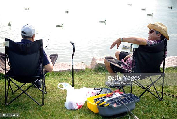 Phil Gallegos right with his dad Jose Gallegos lefton Thursday June 14 2012 as they go fishing with Phil's wife Claudia in Northglenn Phil and his...
