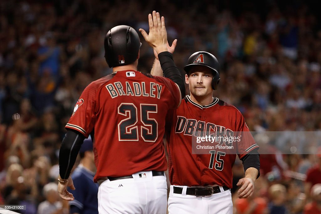 Phil Gosselin #15 of the Arizona Diamondbacks high-fives <a gi-track='captionPersonalityLinkClicked' href=/galleries/search?phrase=Archie+Bradley&family=editorial&specificpeople=7882386 ng-click='$event.stopPropagation()'>Archie Bradley</a> #25 after both scored runs against the San Diego Padres during the second inning of the MLB game at Chase Field on May 29, 2016 in Phoenix, Arizona.