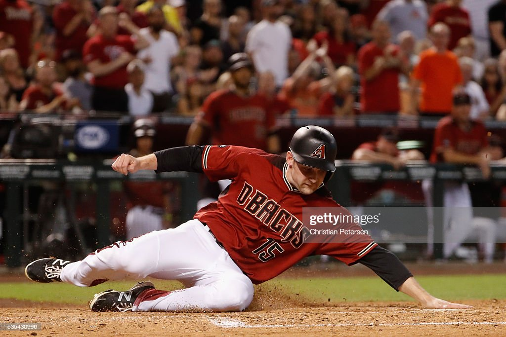 Phil Gosselin #15 of the Arizona Diamondbacks slides into home-plate to score a run against the San Diego Padres during the second inning of the MLB game at Chase Field on May 29, 2016 in Phoenix, Arizona.