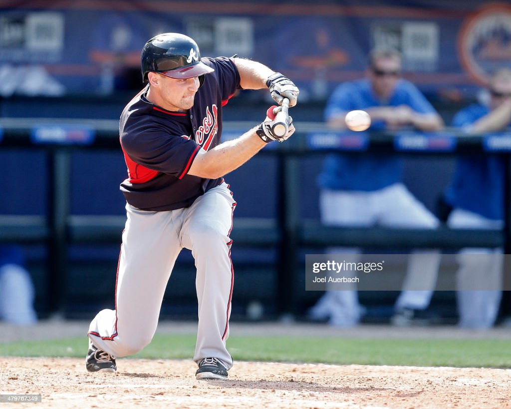 Phil Gosselin #69 of the Atlanta Braves hits a sacrifice bunt to move the runner over to second base against the New York Mets in the ninth inning during a spring training game at Tradition Field on March 20, 2014 in Port St. Lucie, Florida. The Mets defeated the Braves 7-6.